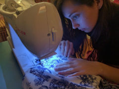 Intently sewing!